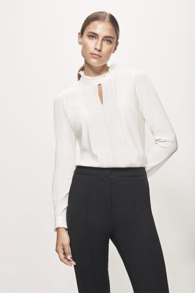 mock neck keyhole silk blouse with black high rise chinos