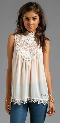 mock neck lace sleeveless blouse with skinny jeans