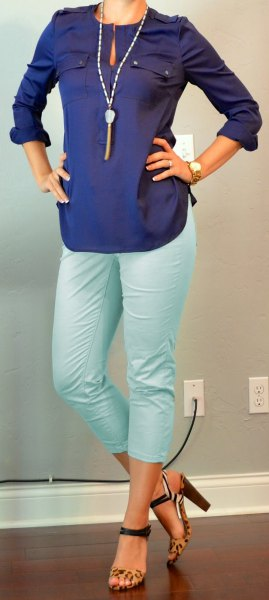 navy blue long sleeve keyhole blouse with white cropped pants