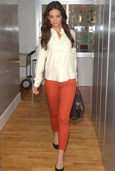 pale yellow chiffon blouse with orange skinny jeans