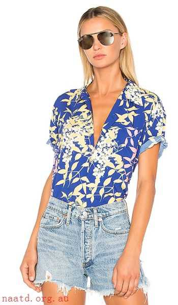 royal blue and white floral print hiking shirt with denim mini shorts