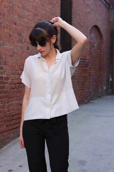 short sleeve button up silk blouse with black slim fit jeans
