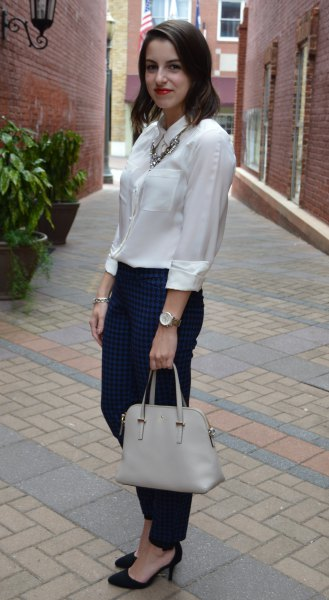 silk button up blouse with black slim fit jeans and heels