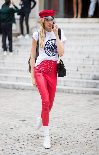 white cool graphic tee with red painter hat and matching leather leggings
