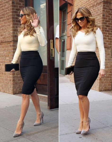 white form fitting sweater with black high waisted bodycon midi skirt
