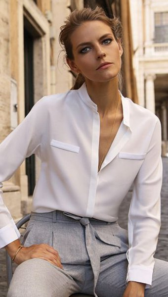 white silk button up semi sheer shirt with grey tie waist chinos