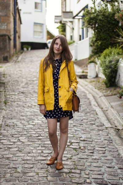 yellow rain jacket with black and white polka dot mini shift dress