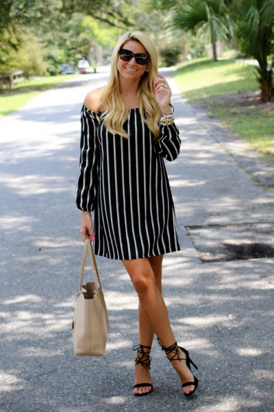 black and white off the shoulder mini shift dress with pink purse