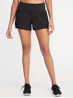 black and white sneakers with cropped sport tank top and mini running shorts