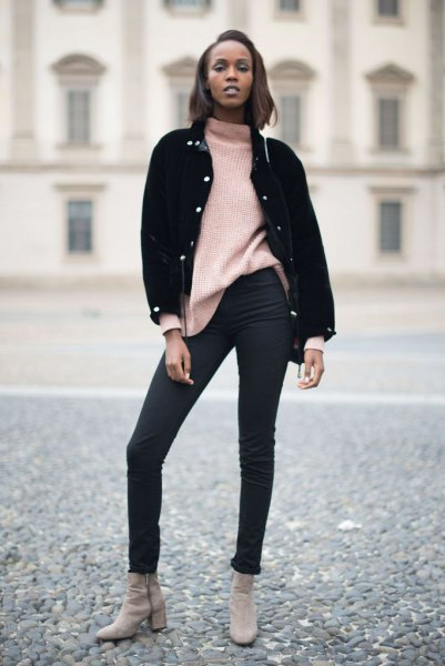 black denim jacket with ivory mock neck chunky sweater and skinny jeans