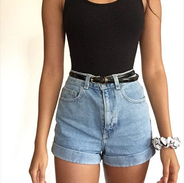 black form fitting tank top with blue vintage high waisted denim shorts