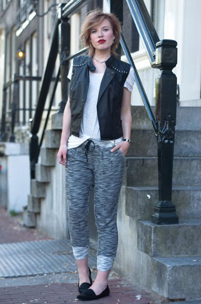 black leather studded vest with grey knit pants