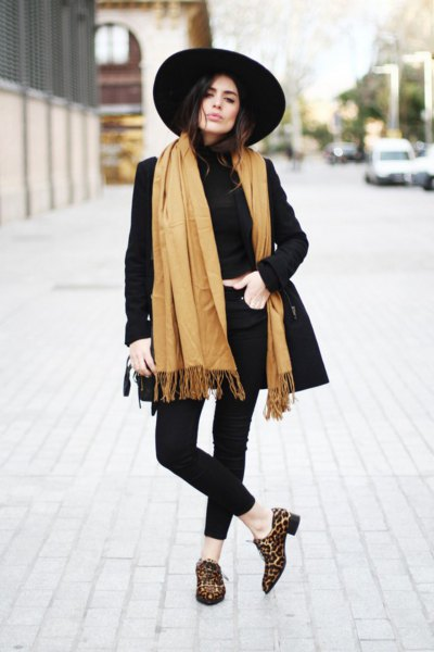black longline blazer with orange fringe scarf and leopard print loafers