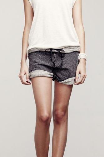 black sleeveless tee with grey cuffed sweatpant shorts