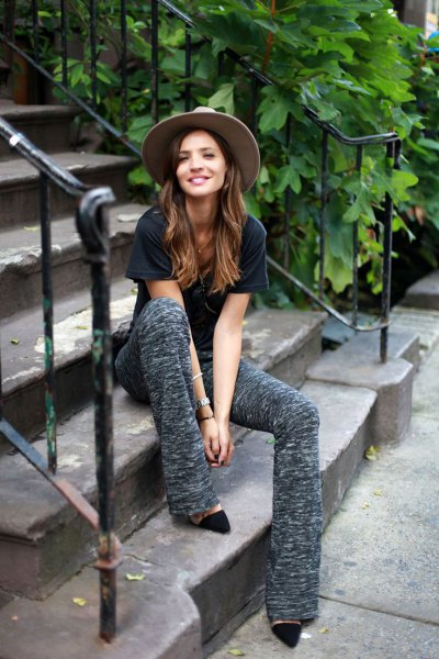 black t shirt with grey flared knit pants and heels