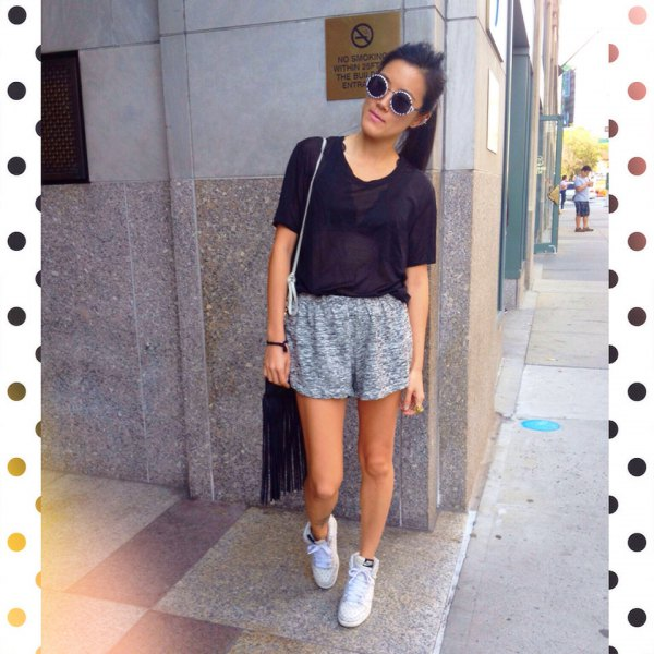 black t shirt with heather grey jogging shorts and white sneakers