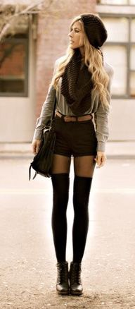 blush pink blouse with black scarf and matching mini shorts