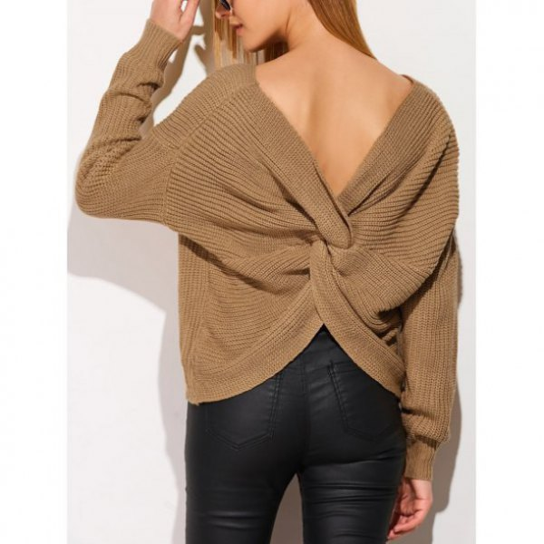 green twist back sweater with black coated skinny jeans