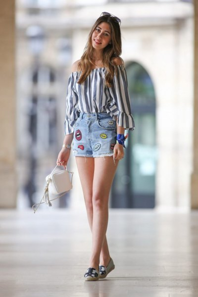 grey and white vertical striped off the shoulder blouse with denim graphic summer shorts