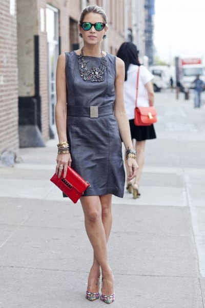 grey belted tank mini dress with red leather clutch handbag