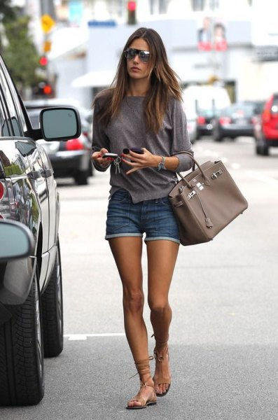 grey long sleeve tee with blue denim mini shorts and strappy sandals