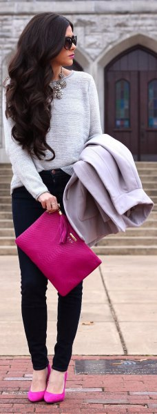 grey pullover sweater with hot pink clutch handbag