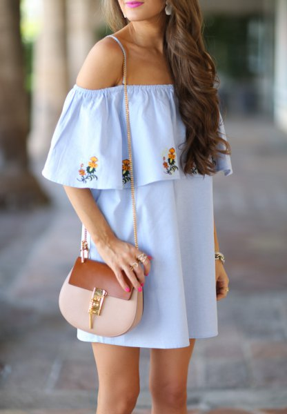 light blue floral embroidered shift dress with pink purse