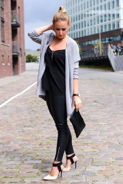 light blue longline sweater cardigan with black clutch handbag