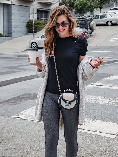 light grey longline cardigan with black tee and knit pants