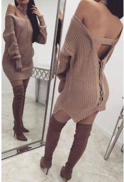 light grey ribbed open back sweater dress with thigh high boots
