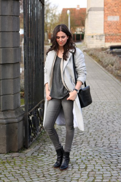 longline light grey coat with oversized t shirt and leather ankle boots