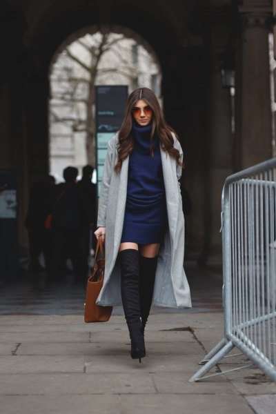 navy blue knit dress with grey maxi blazer and thigh high boots