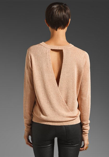 pale pink cutout back sweater with black maxed skinny jeans