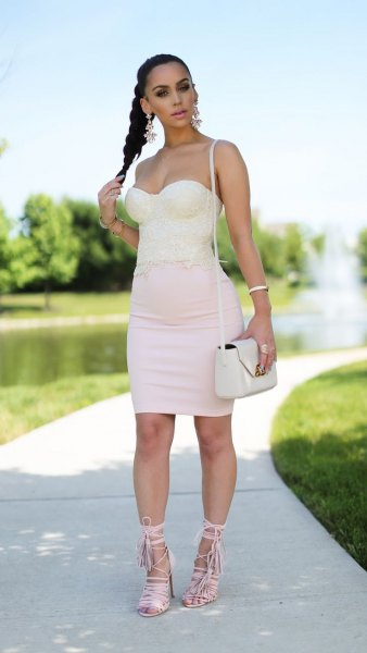 pale pink sweetheart neckline bodycon mini dress with white lace up sandals