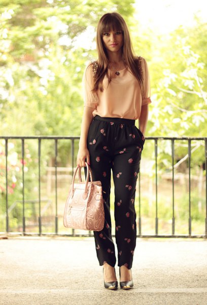 pale yellow chiffon tank top with black floral printed pants