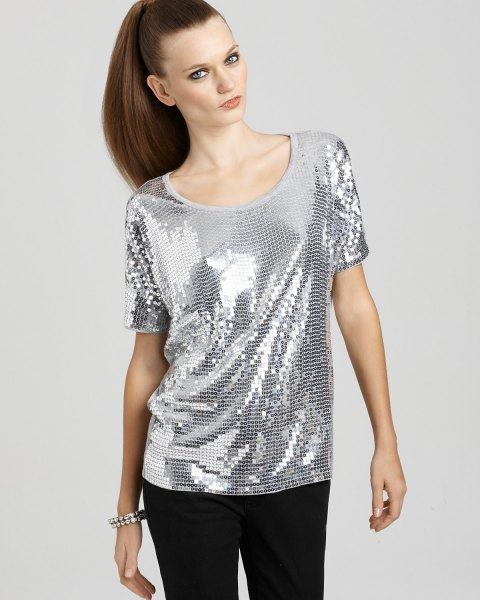 silver scoop neck top with black slim fit pants