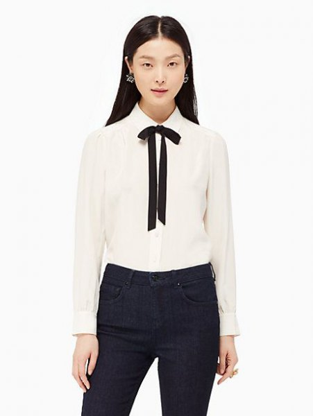 white and black bow tie button up shirt with black skinny jeans