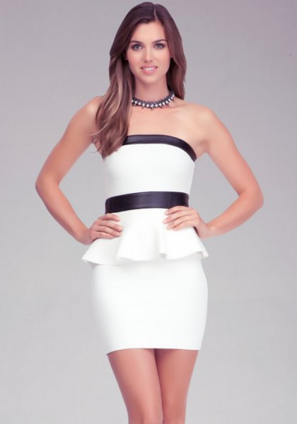 white and black peplum tube top with matching mini bodycon skirt