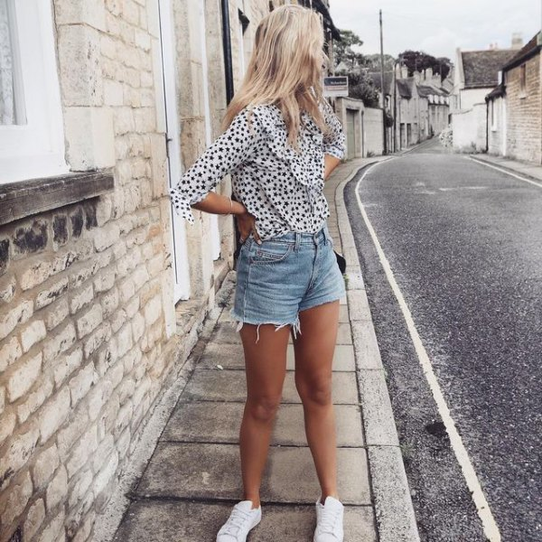 white and black polka dot chiffon blouse with blue high waisted distressed shorts
