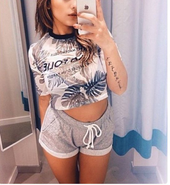 white and blush cropped print tee with grey mini sweatpant shorts