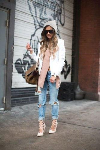 white blazer with grey side slit sweater and boyfriend jeans
