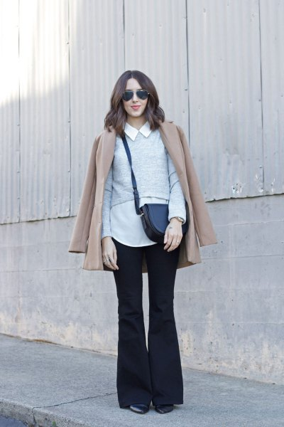 white collar shirt with blush pink coat and black flared jeans