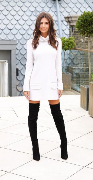 white front pocket sweater dress with black thigh high boots
