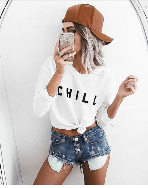 white knotted long sleeve tee with high waisted distressed shorts
