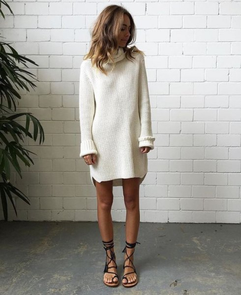 white ribbed sweater dress with black gladiator flat sandals