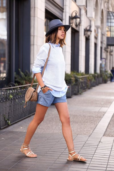 white ripped sweater with blue denim mini shirt and shorts