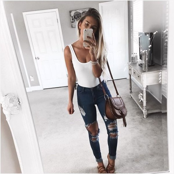 white scoop neck tank top with heavily ripped dark grey skinny jeans