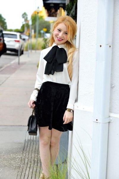 white shirt with black high rise skater skirt