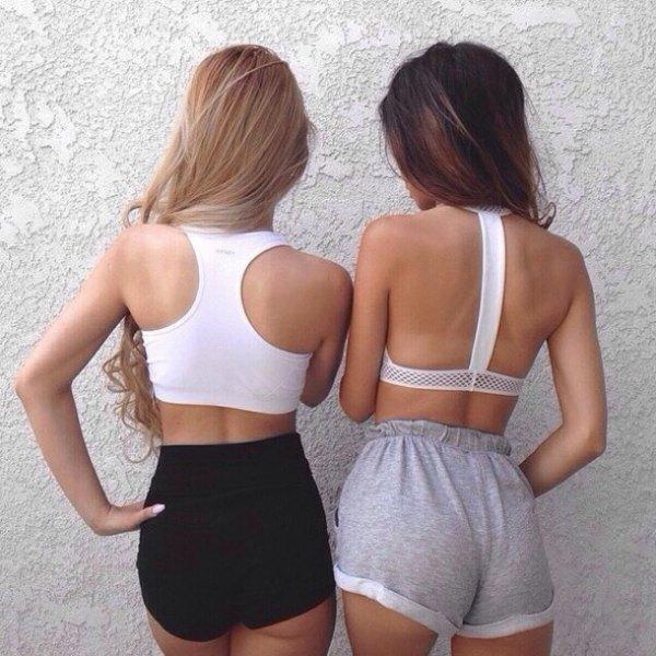 white sport crop top with black mini jogging sweat shorts