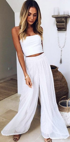 white strapless crop top with flare chiffon pants